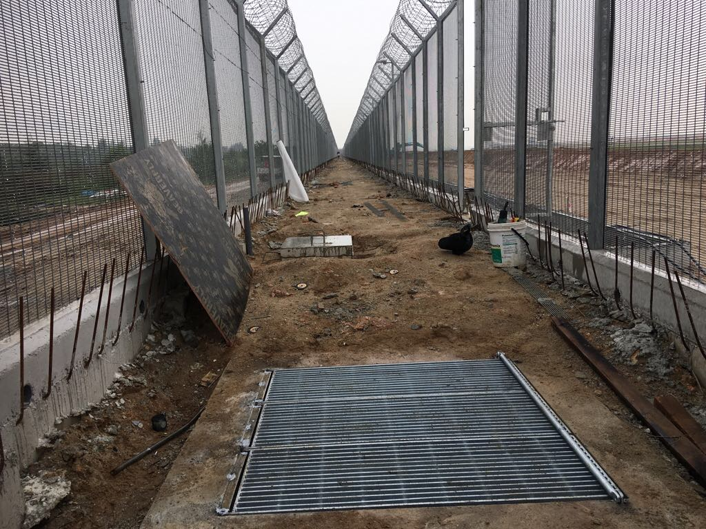 Inside and narrow view of the high BRC fencing coupled with concertina-wire under construction in Singapore
