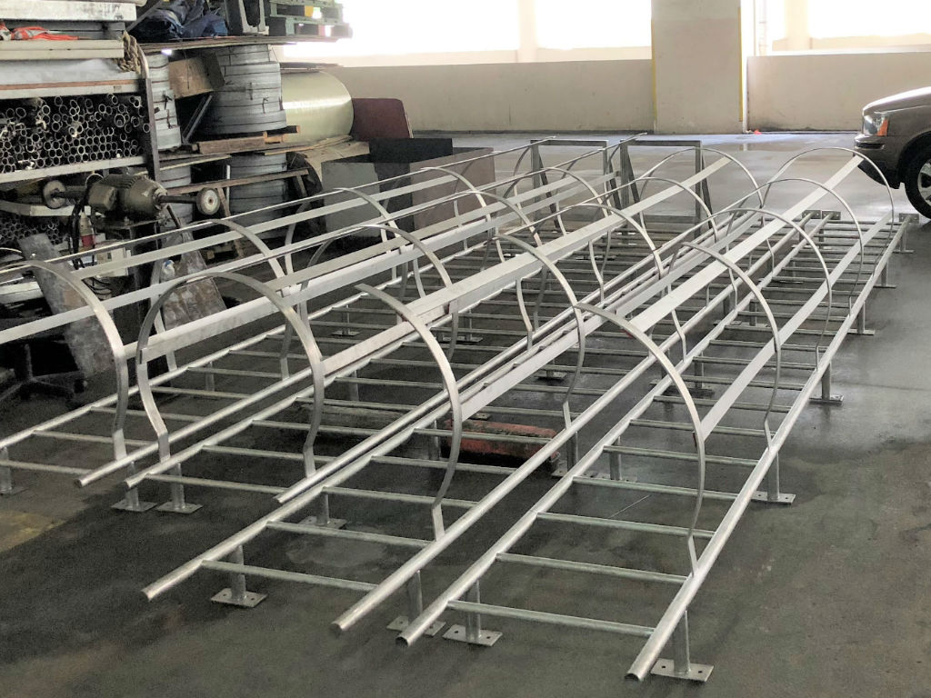 Superior manufacturer in Singapore showing neatly arranged and ready to use cat ladder with cage