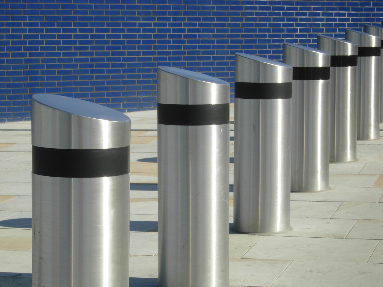 Neatly installed stainless steel city road bollards by Brooklynz metal works Singapore
