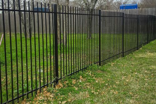 Iron fencing in a lawn area for increased security provided by Brooklynz - fencing supplier