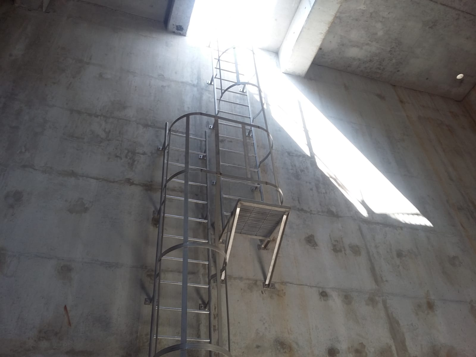 Securely fastened vertical fixed aluminium cat ladder in a building by Brooklynz supplier Singapore
