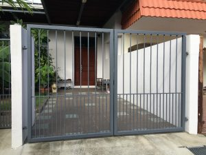 Elegant and simple front metal gate of a home in Singapore