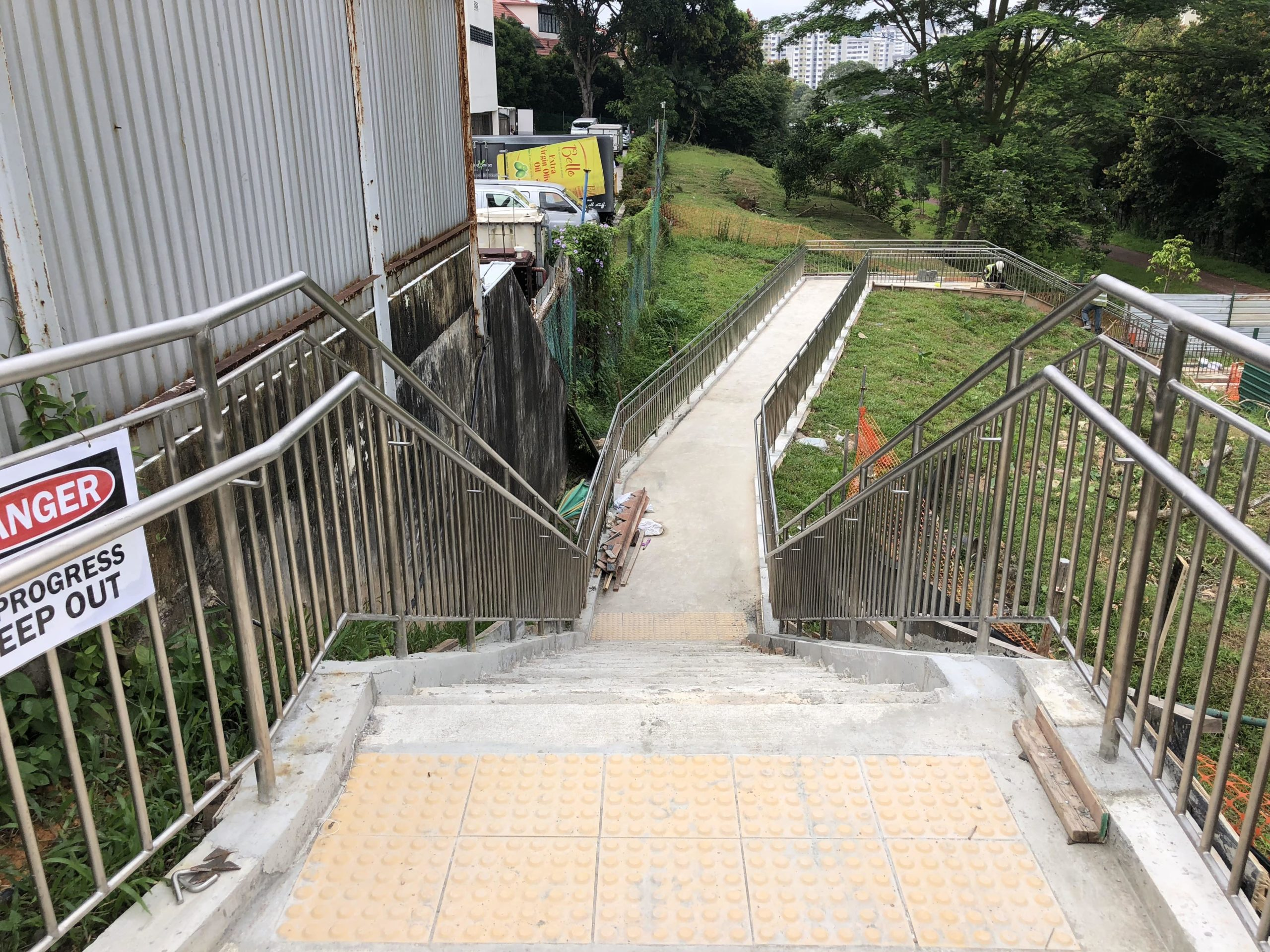 Elevated view of the well constructed stainless steel metal railing situated in a park by Brooklynz Singapore