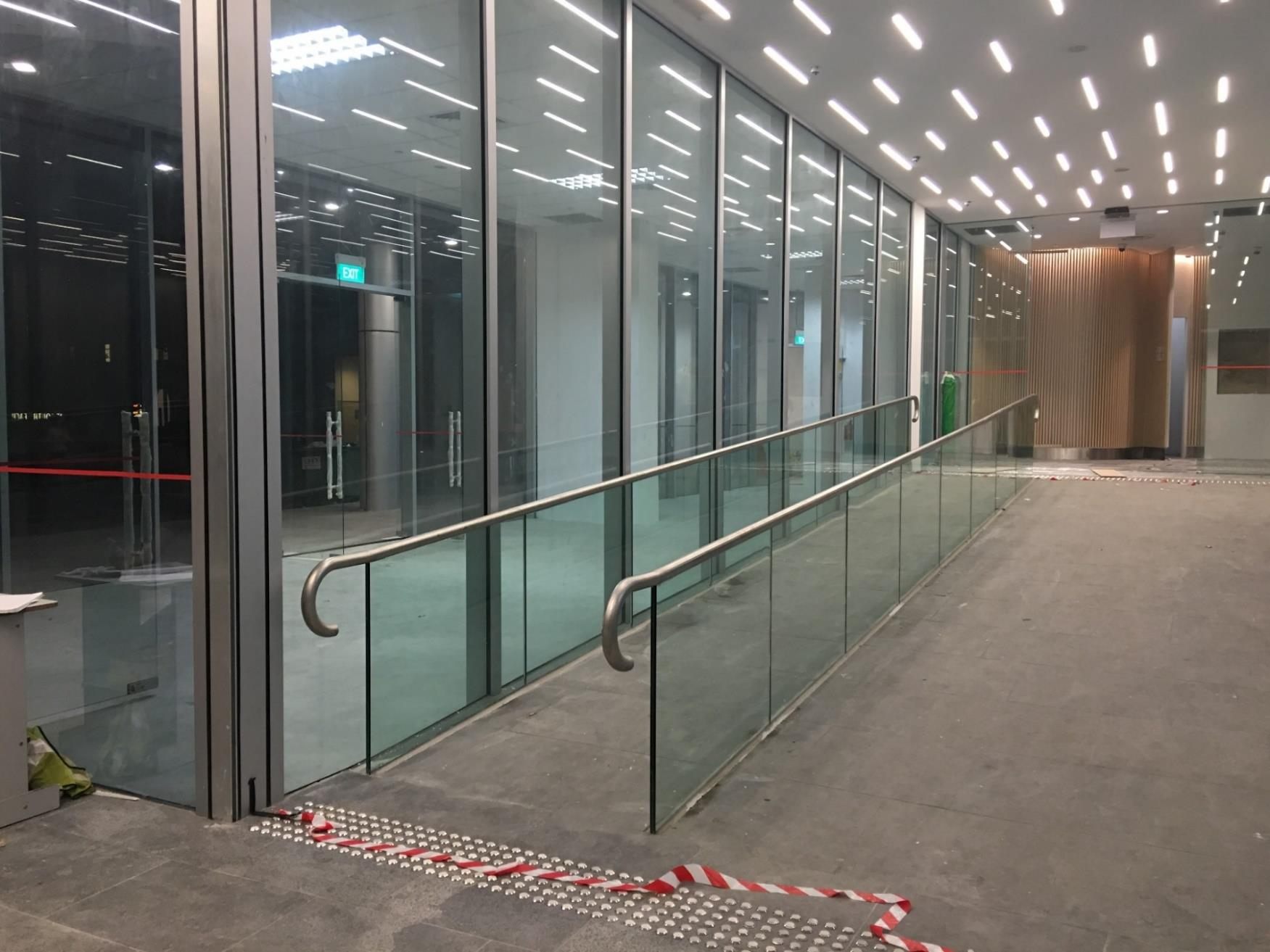 Customized and high quality glass railing of a business complex in Singapore