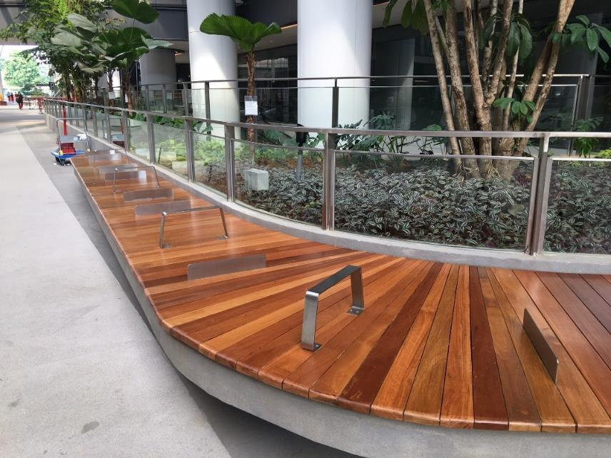 View of stainless steel railing metal works and anti-sleep divider in a common area by Brooklynz Singapore