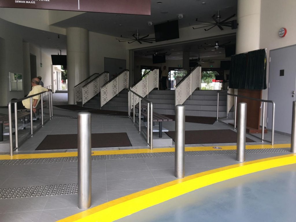 Singapore building with ramp, steps and bollards designed in stainless steel fabrication