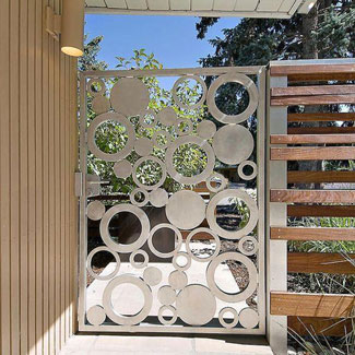 Beautiful stainless steel single leaf outdoor gate with circular patterns from top stainless steel Fabricator Singapore