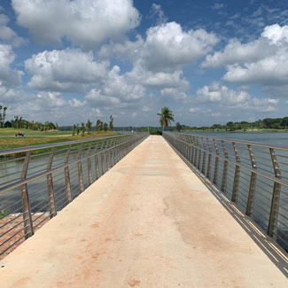 Stunning landscape with water and clouds including an attractive broadwalk over with stainless steel railings