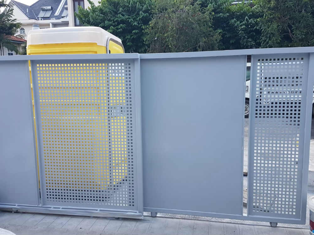 Exceptional quality mild steel gate in blue colour installed outside a residential building