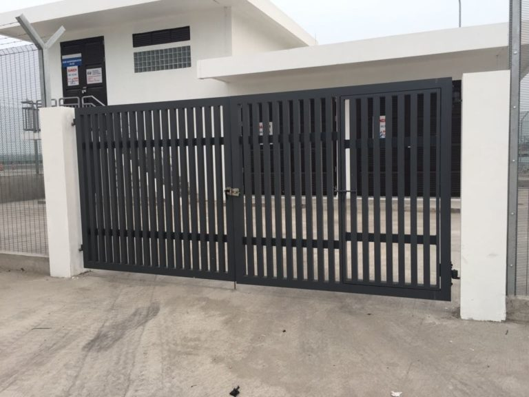 Top grade metal gate at entrance painted in black by Brooklynz