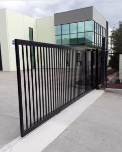 Sliding automatic gate at building entrance by Brooklynz Stainless Steel Company Singapore
